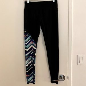 Black leggings with abstract print on right leg